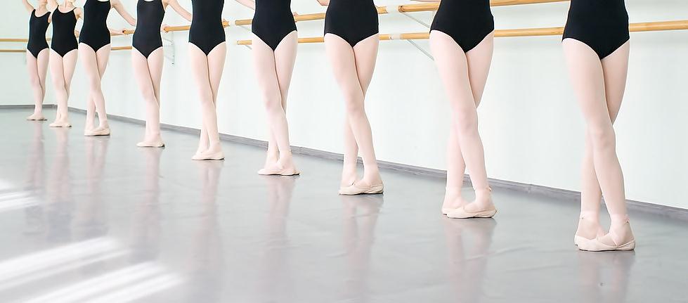 legs of young dancers ballerinas in class classical dance ballet